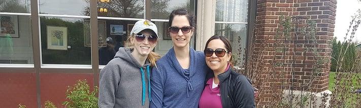 three volunteers in front of Mayslake Peabody Estate