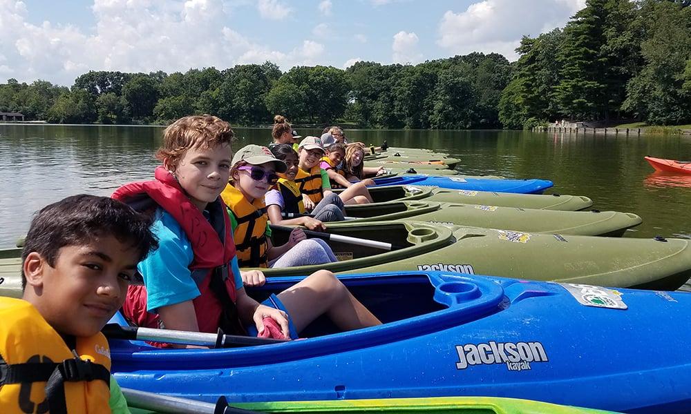 campers-kayaking-herrick-lake