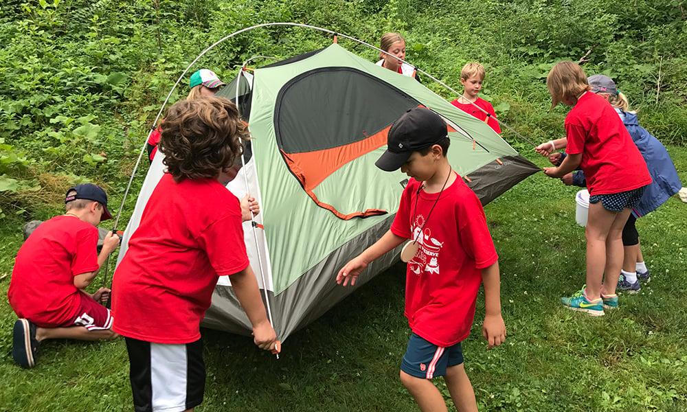campers-set-up-tent