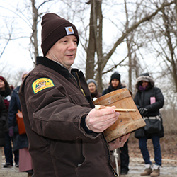 naturalist-dave-andrusyk-holds-bucket-spile