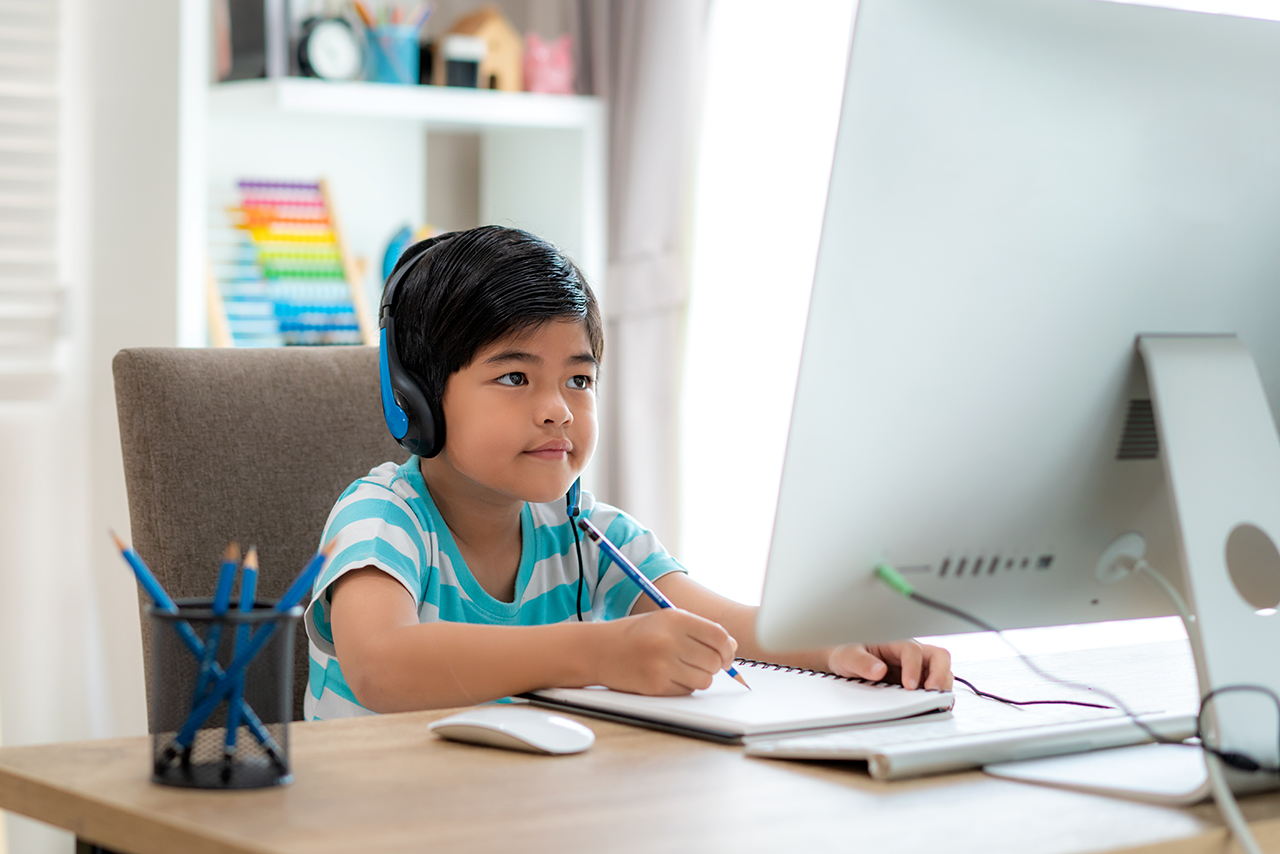virtual-learning-boy-at-computer-with-headphones