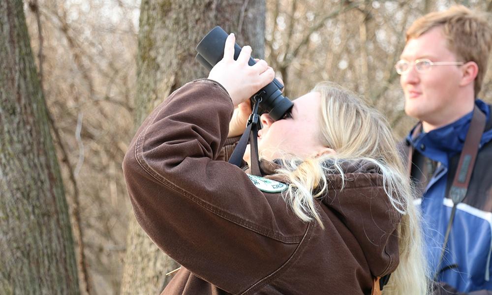 Keriann-Dubina-looks-through-binoculars