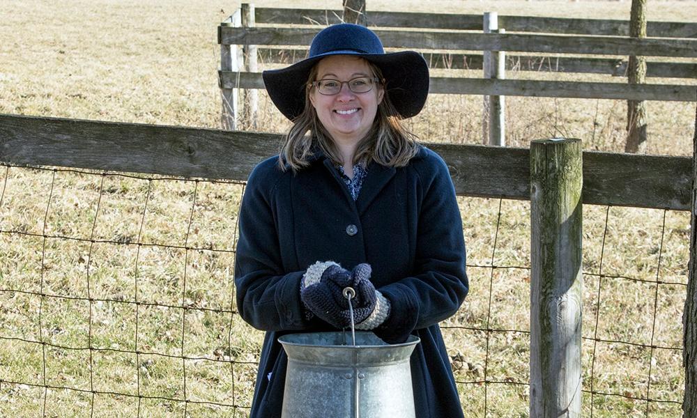 kline-creek-farm-volunteer-with-milkpail