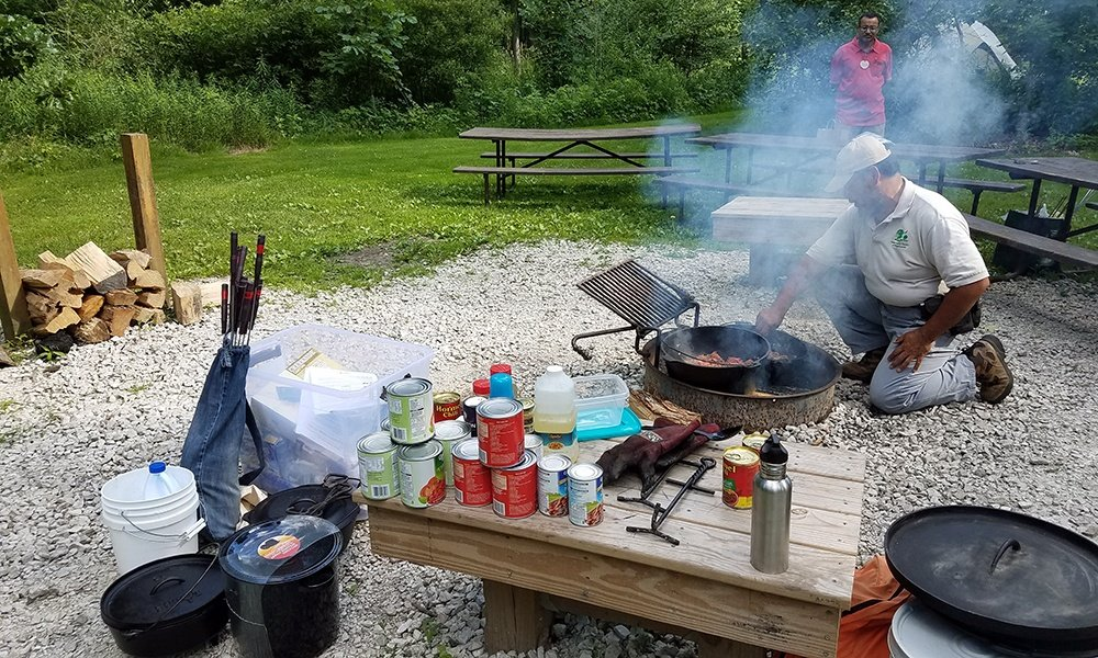 ranger-cooks-over-campfire-great-american-campout