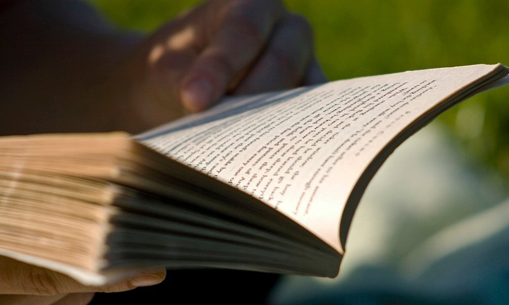 open-book-pages-in-hands-SamGreenhalgh.jpg